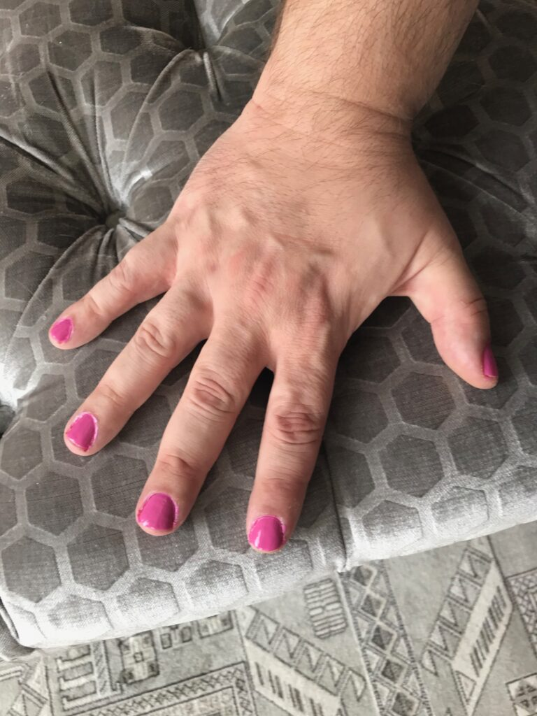 My fingernails, painted pink.  I need to work on avoiding my cuticles with the brush.